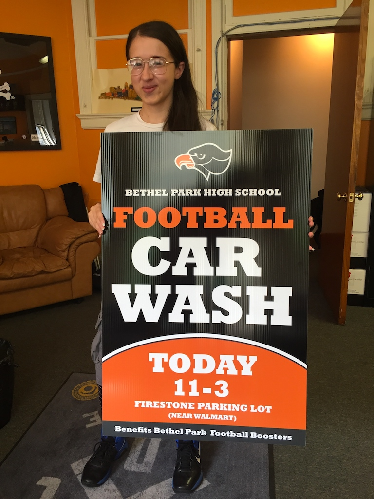 ocreations-graphic-design-bpfootball-carwash-Josephine-with-sign