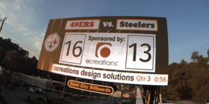 OCREATIONS SPONSORS BILLBOARD DURING STEELERS GAME